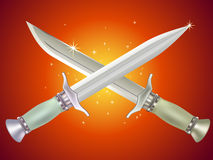 Daggers in shiny background. Two sharp daggers in shiny background Stock Photography