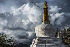 Daggo Kani , the Tibetan Stupa in sunshine , old city gate of Lhasa , Tibet. In the shape of large white chorten , is the old city gate of Lhasa . the southern royalty free stock image