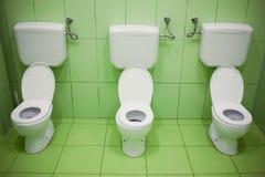 dagiset placerar toaletten arkivbild