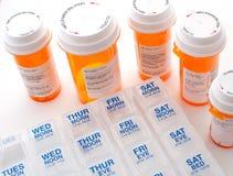 Dagliga receptmedicinrör och fall Arkivbild