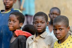 Unidentified Dagomban boys gather together in the local village. DAGOMBA VILLAGE, GHANA - JAN 14, 2017: Unidentified Dagomban boys gather together in the local stock images