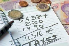 Dagordning med skatt och utländsk valuta Royaltyfria Foton