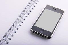 Dagordning och mobiltelefon fotografering för bildbyråer