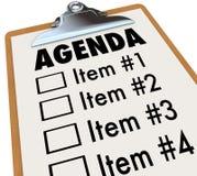 Dagordningen på clipboarden planerar för möte eller projekterar Arkivfoto