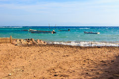 Dahab beach. Boats in the sea on the coast of Dahab Stock Images