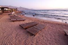 Dahab. restaurant and sun rise with mountains and sea in morning.  royalty free stock images
