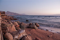 Dahab. restaurant and sun rise with mountains and sea in morning Stock Photos