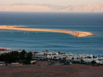 Dahab's spit and distant mountains. This is a general view of the Dahab's gulf with the spit and distant mountains royalty free stock photos