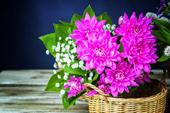 Dahlia bouquet in a wicker basket Royalty Free Stock Photography