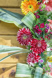 Dahlia and gerbera flowers on wood board Royalty Free Stock Photography
