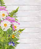 Dahlias flowers and fern bunch on white wooden Royalty Free Stock Photography