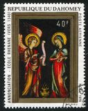 Annunciation. DAHOMEY CIRCA 1970: stamp printed by Dahomey, shows Annunciation, Rhenish School, circa 1970 royalty free stock photo