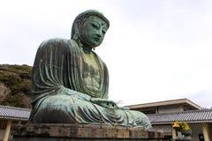 Daibutsu jätte- staty i sammanträdeposition Arkivfoto
