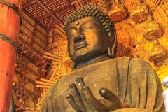 Daibutsu Todai-ji. Nara, Japan - April 26, 2017: Details of Great Buddha or Daibutsu, the world`s largest bronze statue of Buddha Vairocana. Todai-ji a Buddhist Royalty Free Stock Photo