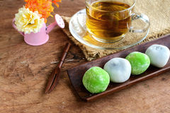 Daifuku green tea and sesame filling with cup of tea on wooden ta Stock Photos