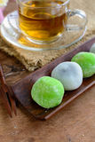 Daifuku green tea and sesame filling with cup of tea on wooden ta Royalty Free Stock Images