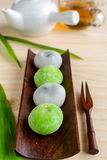 Daifuku greentea and sesame filling with cup of tea on wooden ta Stock Photos