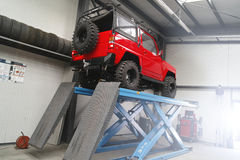 1988 Daihatsu Rocky in car service. Off road car on elevator inside car service waiting for repairs and verification of wheels Stock Photography