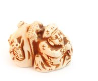 Daikoku netsuke feng shui figurine. On white Royalty Free Stock Image