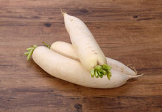 Daikon radish on the wood Stock Images