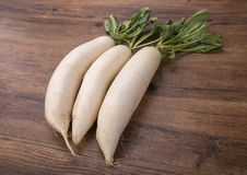 Daikon radish on the wood Royalty Free Stock Images