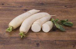 Daikon radish on the wood Stock Photography