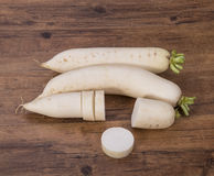 Daikon radish on the wood Royalty Free Stock Photography