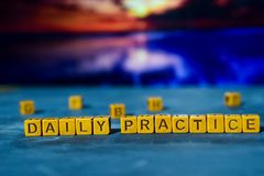 Free Daily Practice On Wooden Blocks. Cross Processed Image With Bokeh Background Stock Photos - 133318383
