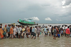 Dailylife of Sundarban-India. People are walking for ferry boat service into the riverbed during the low tide. Water transport is the only means of communication royalty free stock photos