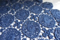 Dainty blue lace on white background. Dainty blue cotton lace on white background stock image