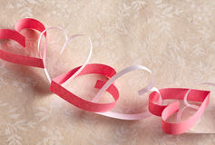 Dainty chain of red and white paper hearts Stock Photos