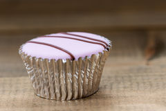 Dainty cupcake with icing design Stock Images