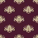 Dainty floral purple and beige seamless pattern. Dainty beige colored floral seamless pattern with decorative beige flower elements  over purple background in Royalty Free Stock Image