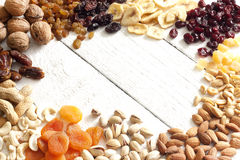 Dainty nuts and dried fruits Royalty Free Stock Images