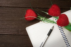 Dairy book and pen with artificial flowers . Royalty Free Stock Image