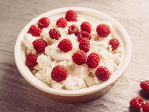 Dairy curd with ripe raspberries Stock Photos