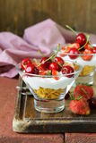 Dairy dessert with cherries and strawberries Royalty Free Stock Photo