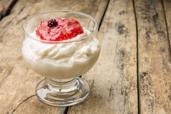 Dairy dessert with raspberry jam and Fresh blueberry Royalty Free Stock Image