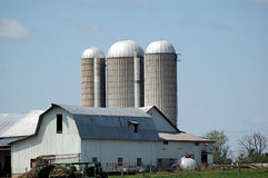 Dairy farm with silos. A view of a set of farm buildings in upstate New York including barns and silos Stock Image