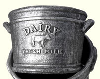 Dairy fresh milk. A gray dairy fresh milk churn on a creamy white background Royalty Free Stock Images