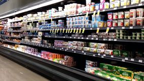 Dairy and frozen food corridor in Save on Foods. stock video footage