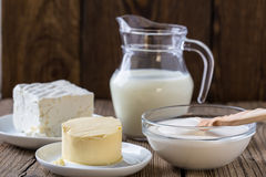 Dairy milk products. Cheese, milk,  sour cream,  butter on rustic wooden background Stock Photos