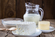 Dairy milk products. Cheese, milk,  sour cream,  butter on rustic wooden background Stock Photo