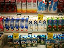 Dairy milk products in gourmet supermarket. A photo showing the large selection of different types of dairy milk products from different regions of the world stock image