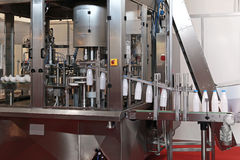 Dairy packaging line. Dairy packaging and filling systems in milk factory Stock Images