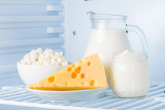 Dairy produce. Tasty healthy dairy products in the refrigerator: sour cream in the bank, cottage cheese in bowl, cheese and milk in a jar royalty free stock image