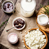 Dairy product: milk, yoghurt and cottage cheese on dark wooden table. Stock Image