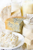 Dairy products. Dairy products on a white wooden board Stock Image
