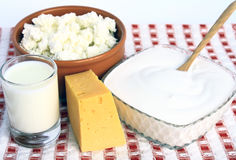 Dairy products. Cottage cheese, sour cream, milk and cheese on a colored background Stock Photo