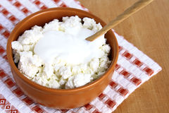 Dairy products. Cottage cheese and sour cream in the clay bowl Royalty Free Stock Photos